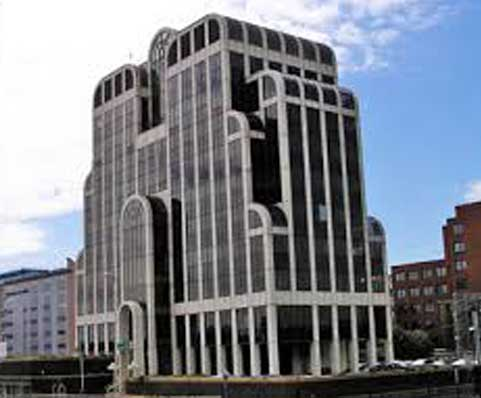 The giant M-shaped McCarthy and Stone's headquarters in Bournemouth is a monument to the achievement of john McCathy